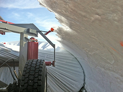 GrainBoss working in a snowbank